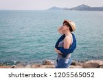 windy summer days relaxing on... | Shutterstock . vector #1205565052