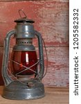 antique red glass oil lamp on... | Shutterstock . vector #1205582332