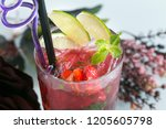 a cup of strawberry juice in... | Shutterstock . vector #1205605798