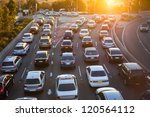 Cars Stuck In Traffic At An...
