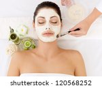 young woman at spa salon with... | Shutterstock . vector #120568252