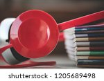 headphones on tob of books | Shutterstock . vector #1205689498