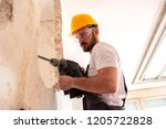 chiseling of a concrete wall... | Shutterstock . vector #1205722828