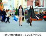 two elegant women shopping in the city stores - stock photo
