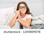 an intellectual look. happy... | Shutterstock . vector #1205809078