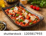 cod in italian in tomatoes with ... | Shutterstock . vector #1205817955