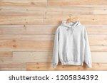 new hoodie sweater with hanger... | Shutterstock . vector #1205834392