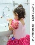 little toddler girl in dress in ...   Shutterstock . vector #1205866348