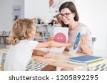 smiling counselor holding... | Shutterstock . vector #1205892295