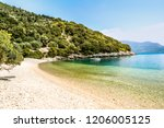 empty beach with a boat on... | Shutterstock . vector #1206005125
