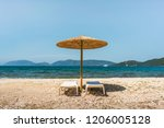 umbrella and two sun beds on a... | Shutterstock . vector #1206005128