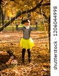 girl in halloween holiday is... | Shutterstock . vector #1206044998