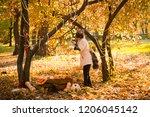girl in halloween holiday is... | Shutterstock . vector #1206045142