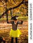 girl in halloween holiday is... | Shutterstock . vector #1206045145