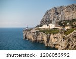 Gibraltar, United Kingdom, 2nd October 2018:-Gibraltar crematorium with Europa Point lighthouse in the background, Europa Point, Gibraltar. Gibraltar is a British Overseas Territory. - stock photo