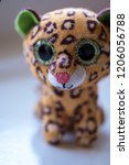 a small soft leopard toy with...