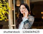 beautiful stylish woman talking ... | Shutterstock . vector #1206069625
