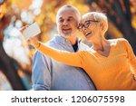 active seniors taking selfies...   Shutterstock . vector #1206075598