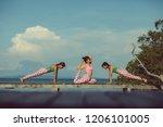three asian woman playing yoga... | Shutterstock . vector #1206101005