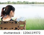 woman praying and reading on...   Shutterstock . vector #1206119572