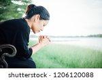 christian asian woman praying...   Shutterstock . vector #1206120088