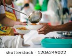 donate food to hungry people ... | Shutterstock . vector #1206249022