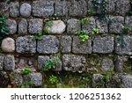 ancient wall of gray stones... | Shutterstock . vector #1206251362