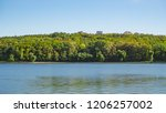 green coast line of the lake.... | Shutterstock . vector #1206257002