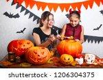 happy halloween  mother and her ... | Shutterstock . vector #1206304375