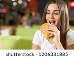 hungry female client sitting in ... | Shutterstock . vector #1206331885