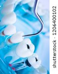 dentist cleaning teeth with...   Shutterstock . vector #1206400102