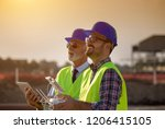 two engineers with helmets and... | Shutterstock . vector #1206415105