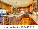 Stock photo mountain luxury home with wood kitchen and granite countertop 120645712