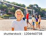 happy boy standing on beach... | Shutterstock . vector #1206460738