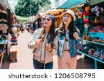 pretty backpackers cheerfully... | Shutterstock . vector #1206508795