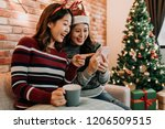 best friends with santa hat and ... | Shutterstock . vector #1206509515