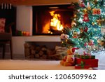 christmas tree with presents at ...   Shutterstock . vector #1206509962