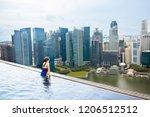 children swimming in roof top...   Shutterstock . vector #1206512512