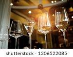empty glasses wine in... | Shutterstock . vector #1206522085
