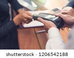 businessman paying by credit... | Shutterstock . vector #1206542188
