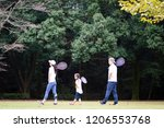 family with tennis racket | Shutterstock . vector #1206553768
