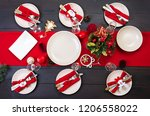 prepared christmas table for... | Shutterstock . vector #1206558022
