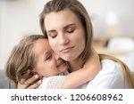 cute little girl hug young mom  ... | Shutterstock . vector #1206608962