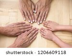 top view of hands of three... | Shutterstock . vector #1206609118