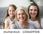 portrait of smiling three... | Shutterstock . vector #1206609508