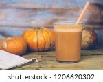 healthy pumpkin smoothie with... | Shutterstock . vector #1206620302