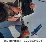 worker with a heat gun is... | Shutterstock . vector #1206634105
