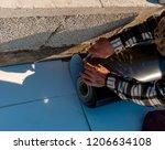 worker with a heat gun is... | Shutterstock . vector #1206634108