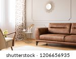 gold mirror on grey wall with...   Shutterstock . vector #1206656935