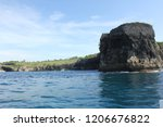 cliff island on steady sea water | Shutterstock . vector #1206676822